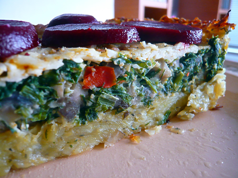 Mushroom quiche with potato crust topped with beetroot