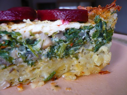 Yummy quiche with pickled beetroot decor