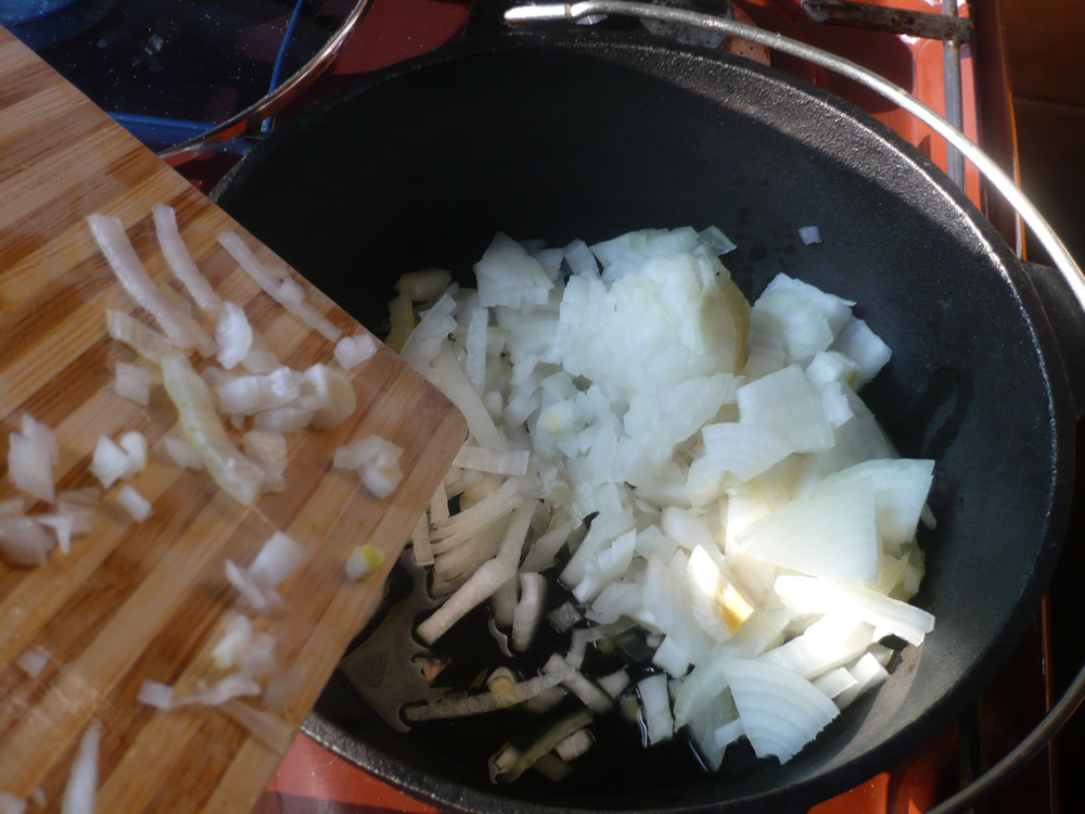 Cooking onion in hot olive oil